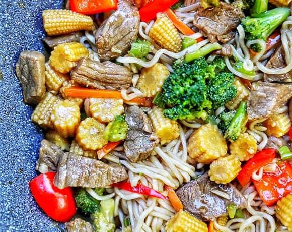 half side of beef lo mein in pan