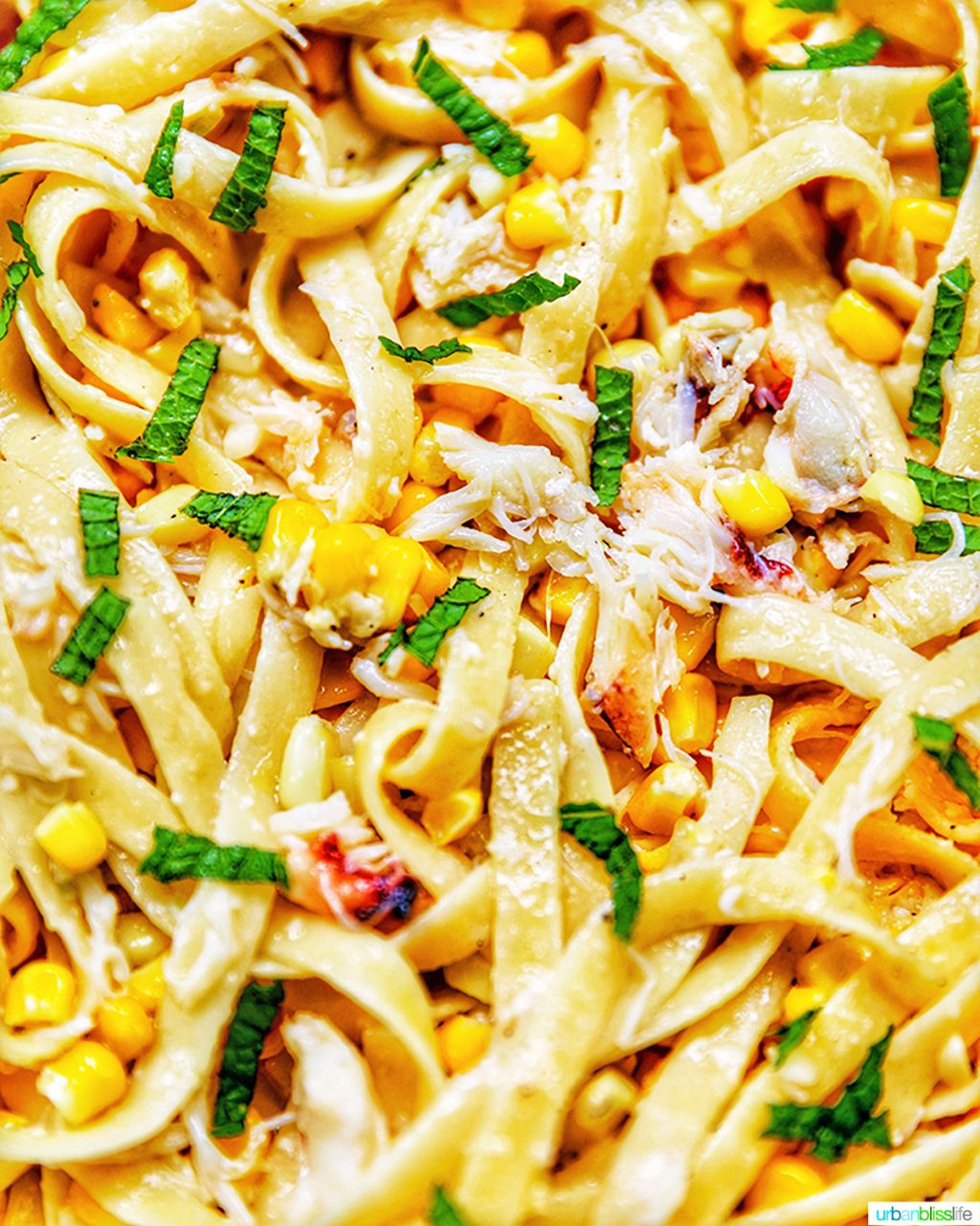 zoom in of pasta with crab and corn