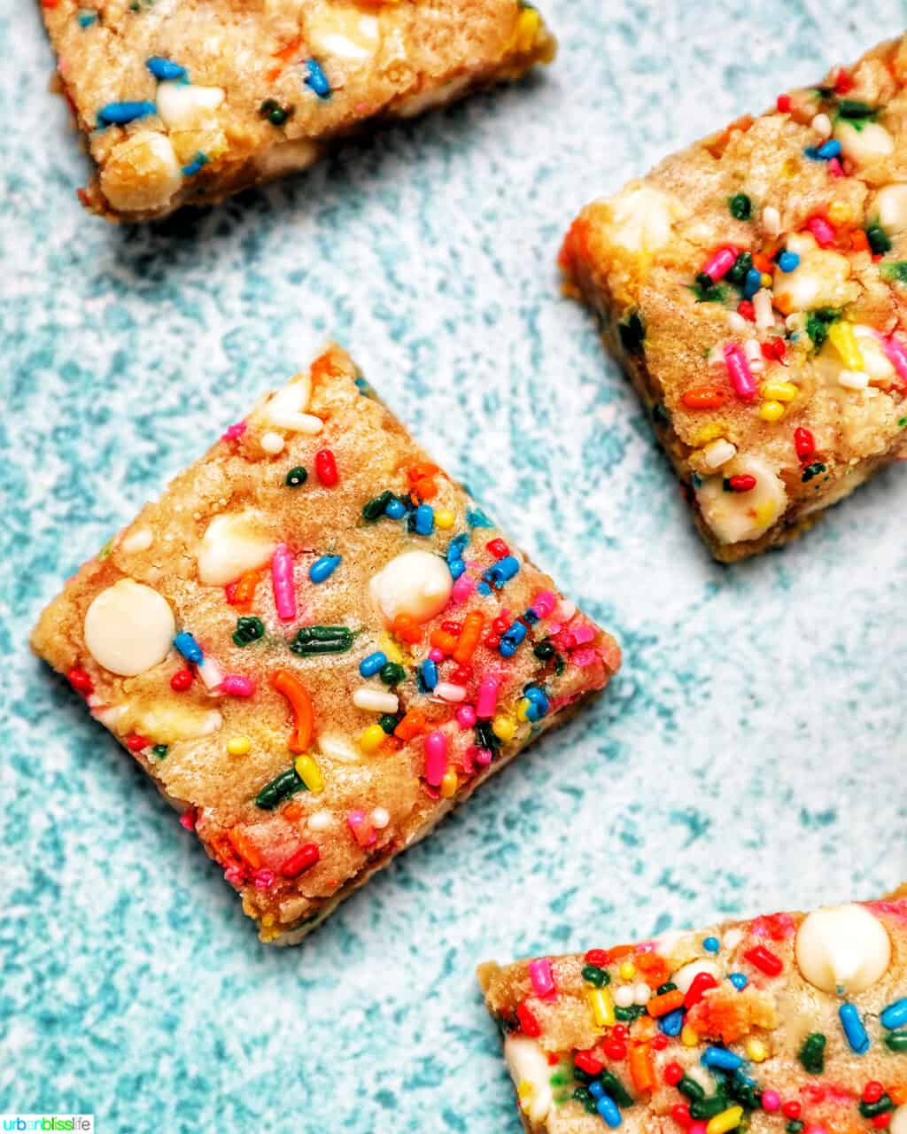 Funfetti Cookie Bars sliced on blue background