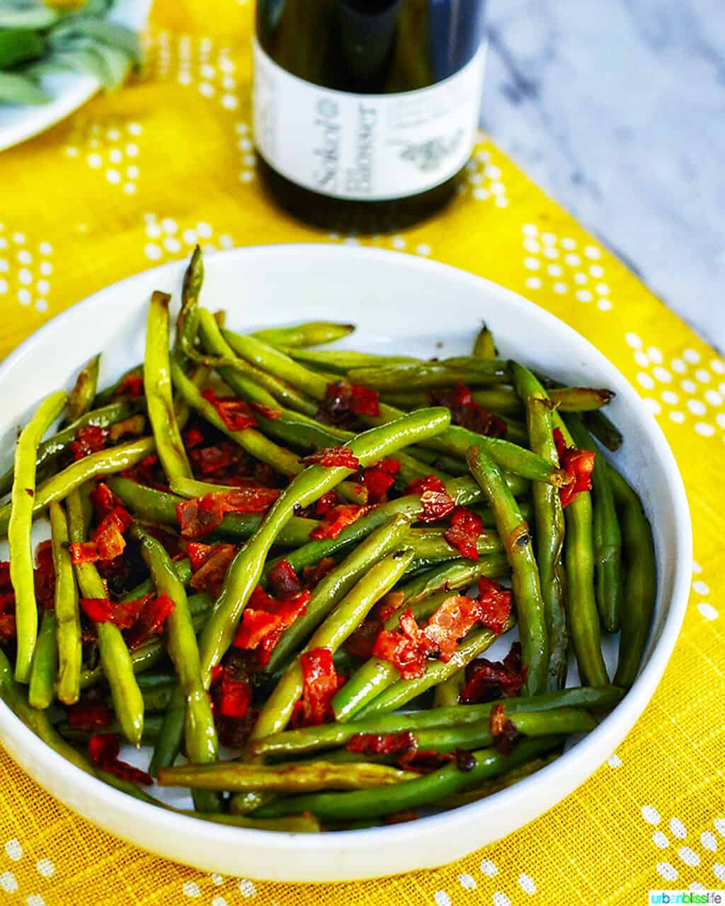 green beans with bacon with bottle of wine