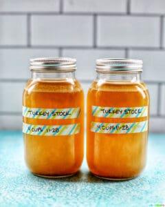 two mason jars full of Homemade Turkey Stock