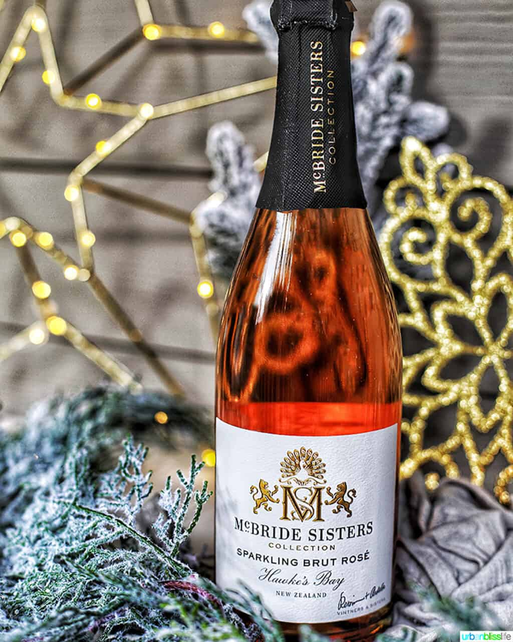 McBride Sisters Brut Rosé bottle in holiday decorations