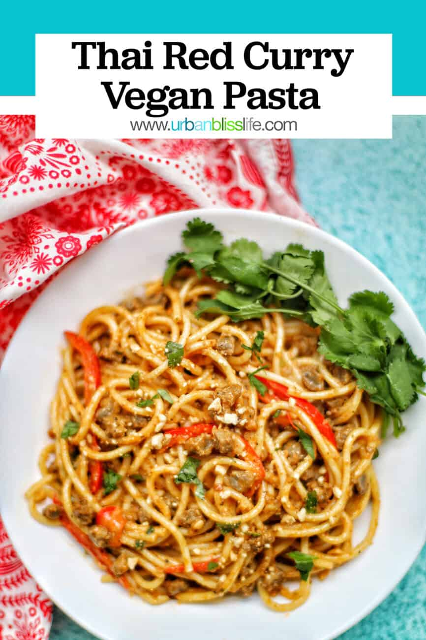 single bowl of Thai Red Curry Pasta with red napkin blue background and title text