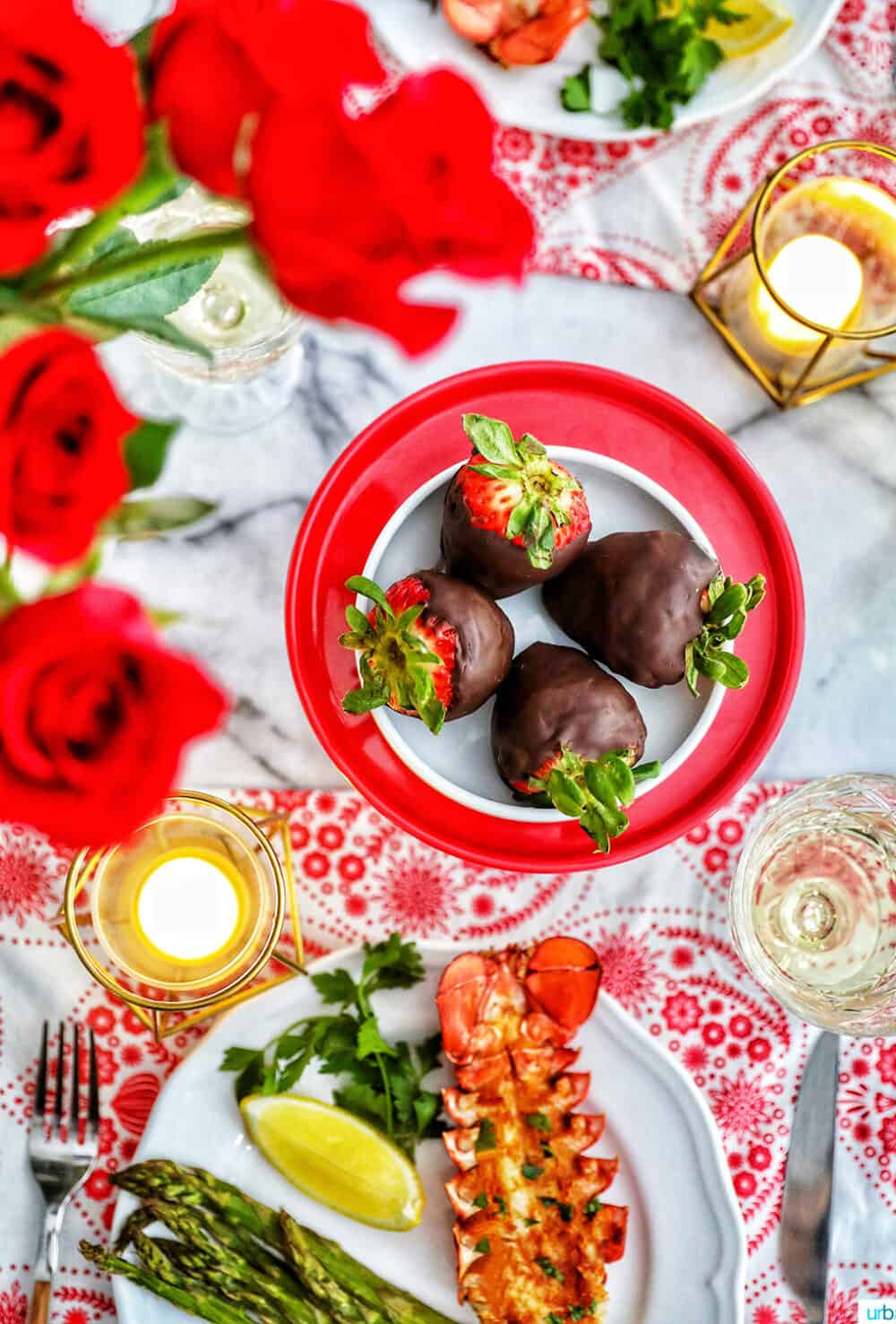 Valentine's Day dinner lobster chocolate covered strawberries roses candles wine