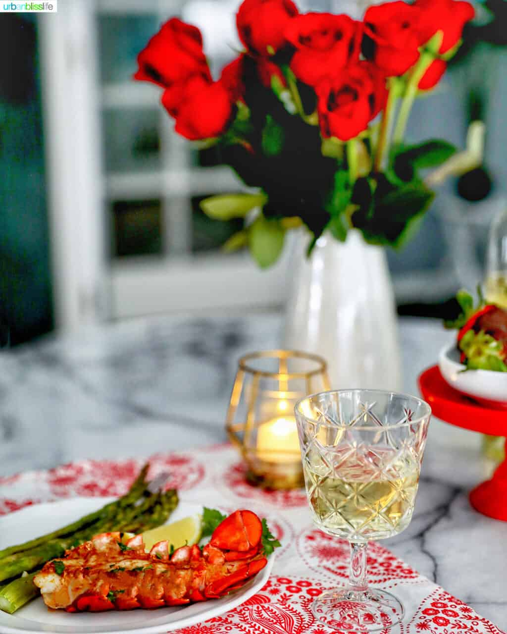 Valentine's Day dinner lobster chocolate covered strawberries, roses, candles, and wine