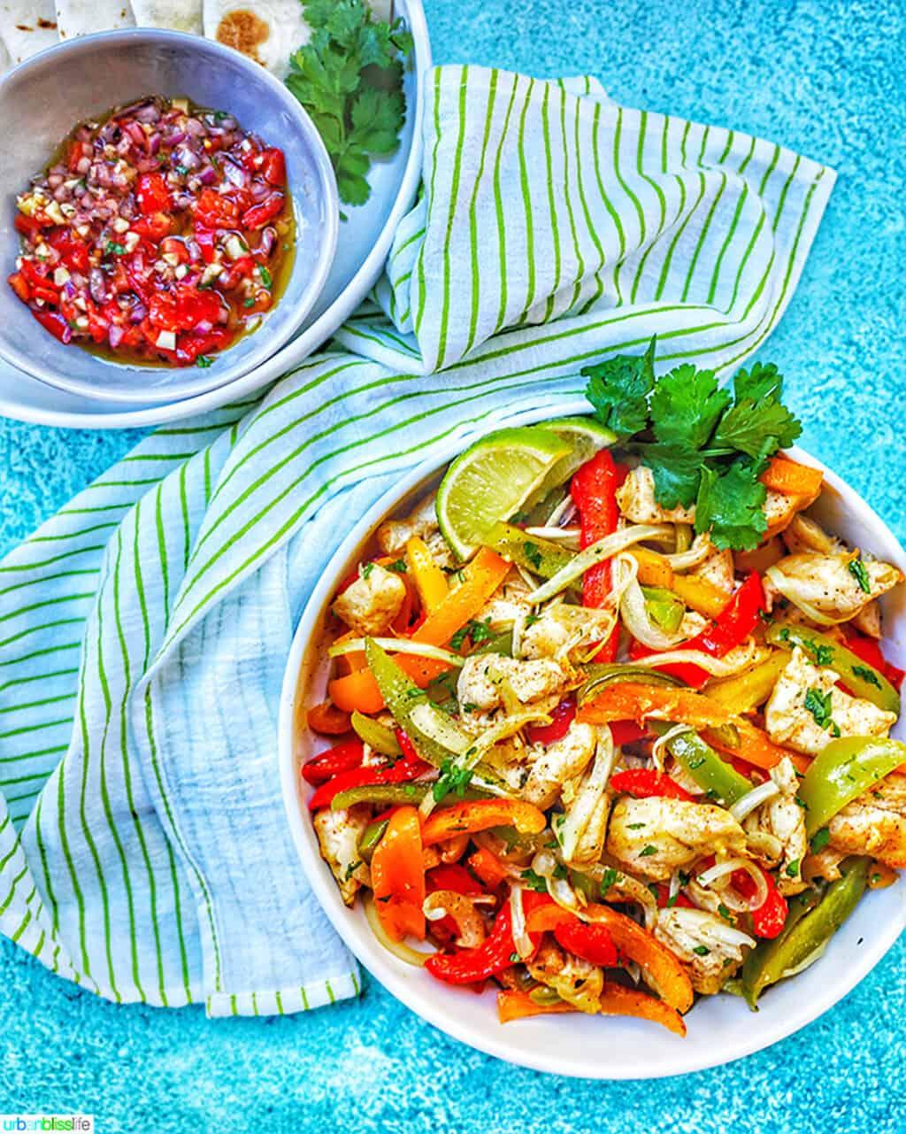 big bowl of Sheet Pan Chicken Fajitas and salsa