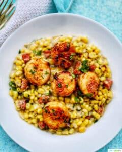 Seared Scallops and Corn in white bowl