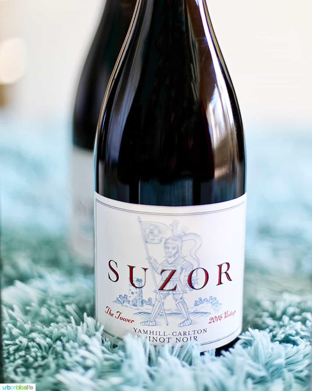 bottle of Suzor Oregon Pinot Noir on fluffy blue blanket