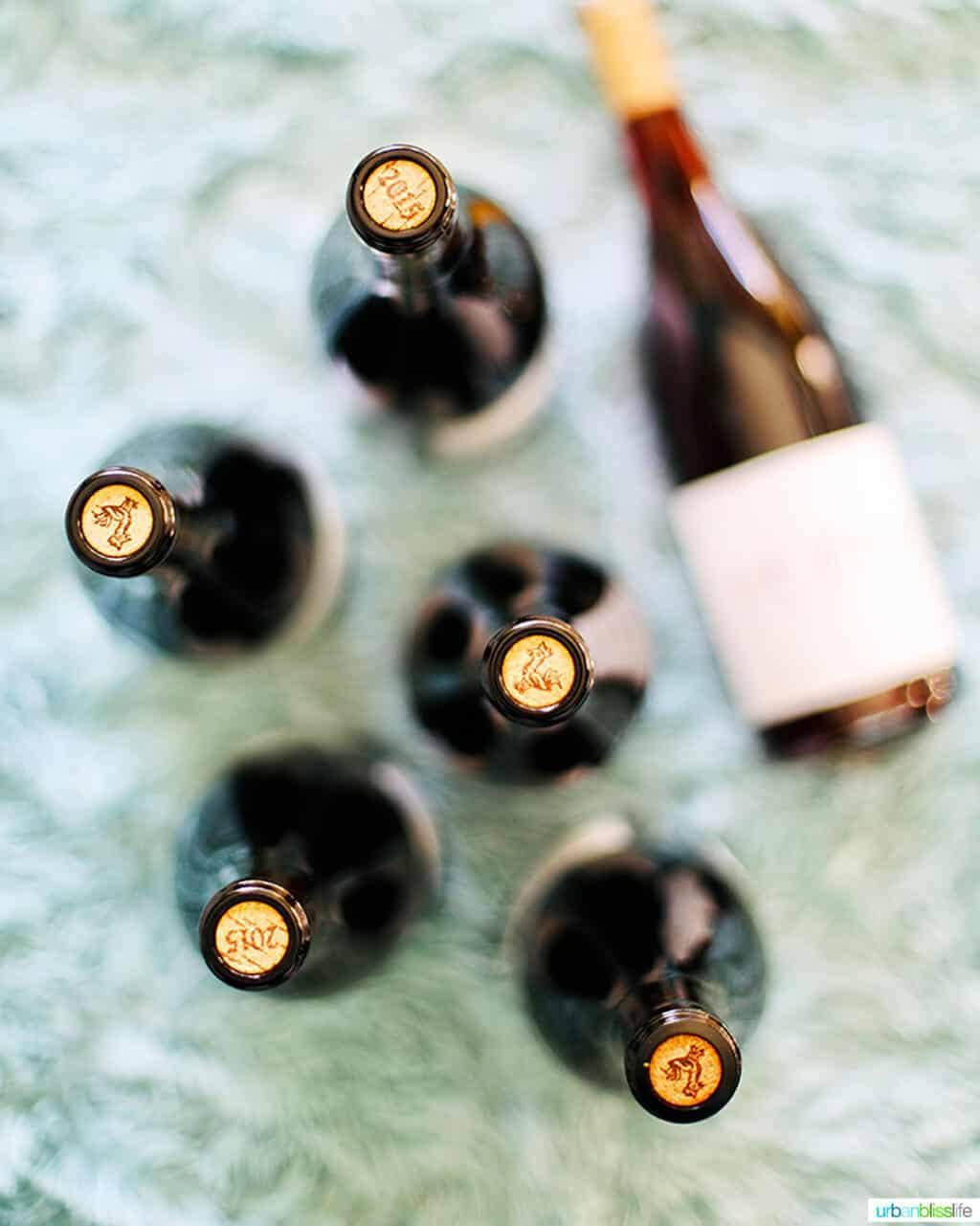 oregon pinot noir bottles corks on blue blanket