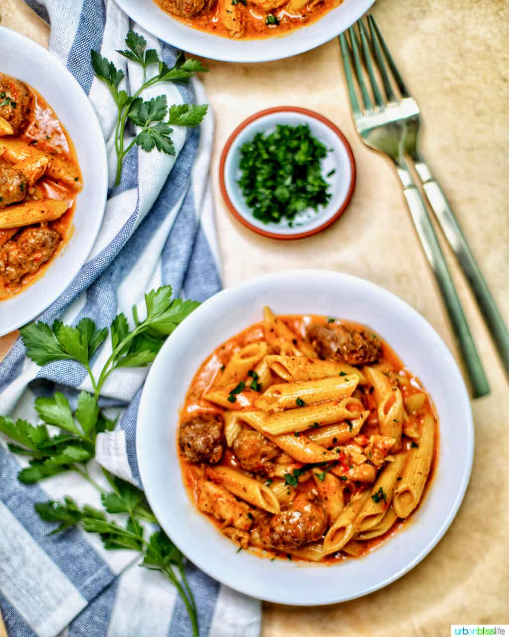 bowls of Instant Pot Cajun Chicken Pasta with forks