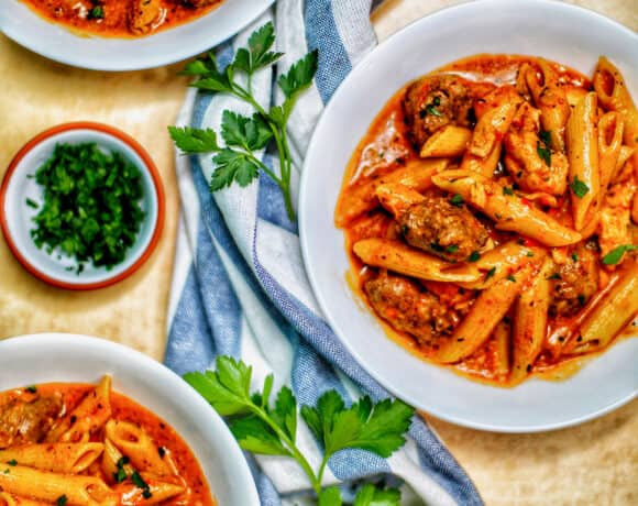 bowls of Instant Pot Cajun Chicken Pasta with greenery