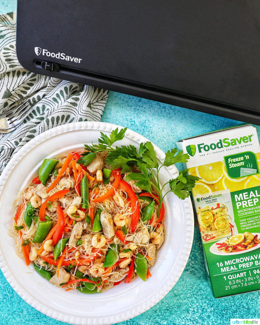 bowl of Filipino Pancit Bihon with FoodSaver machine and Meal Prep Bags