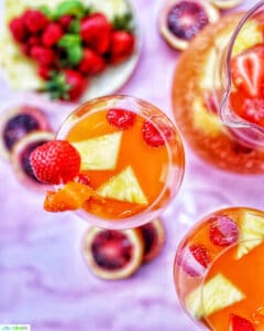 glasses of tropical sangria and fruit